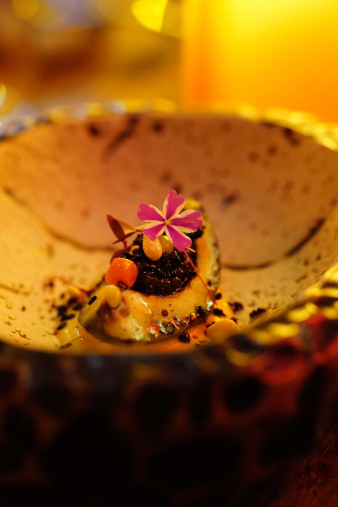 Avocado in flames, Osetra caviar, pink pepper corn-citrus cream with guava and geranium salad