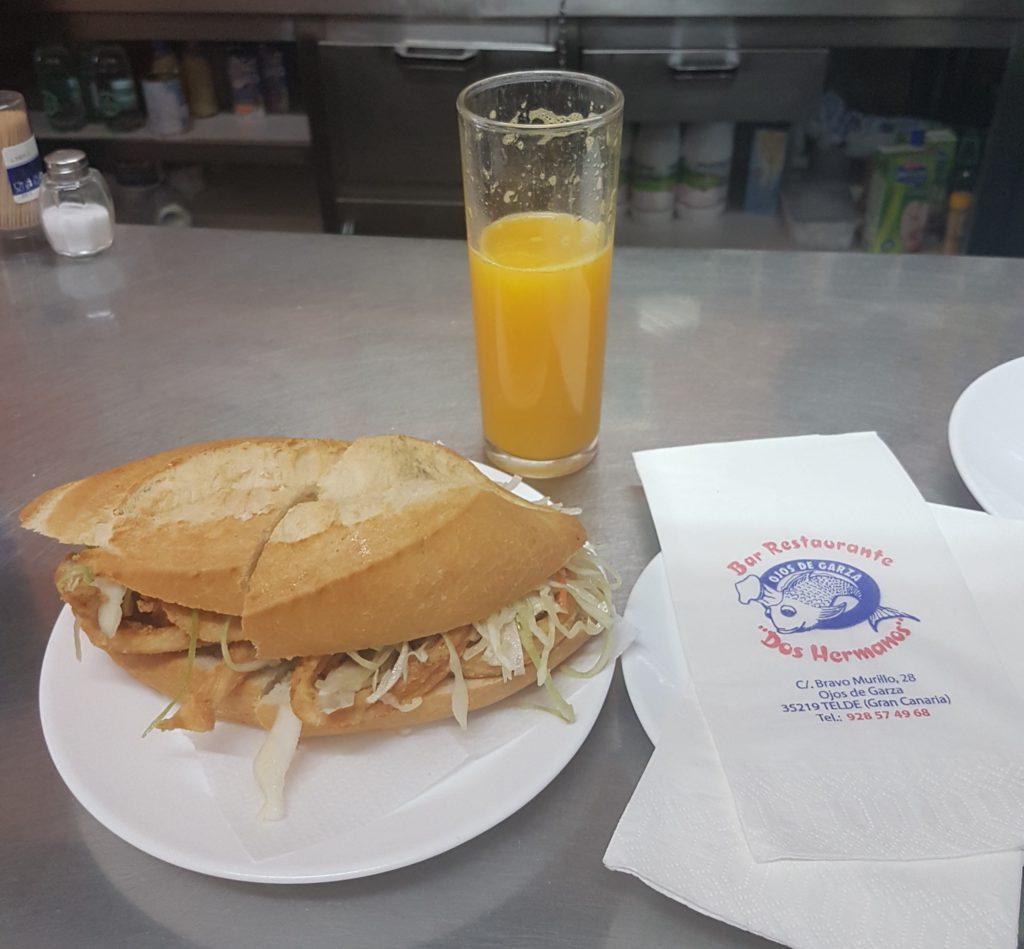 Calamari sandwich with cabbage salad and fresh orange juice