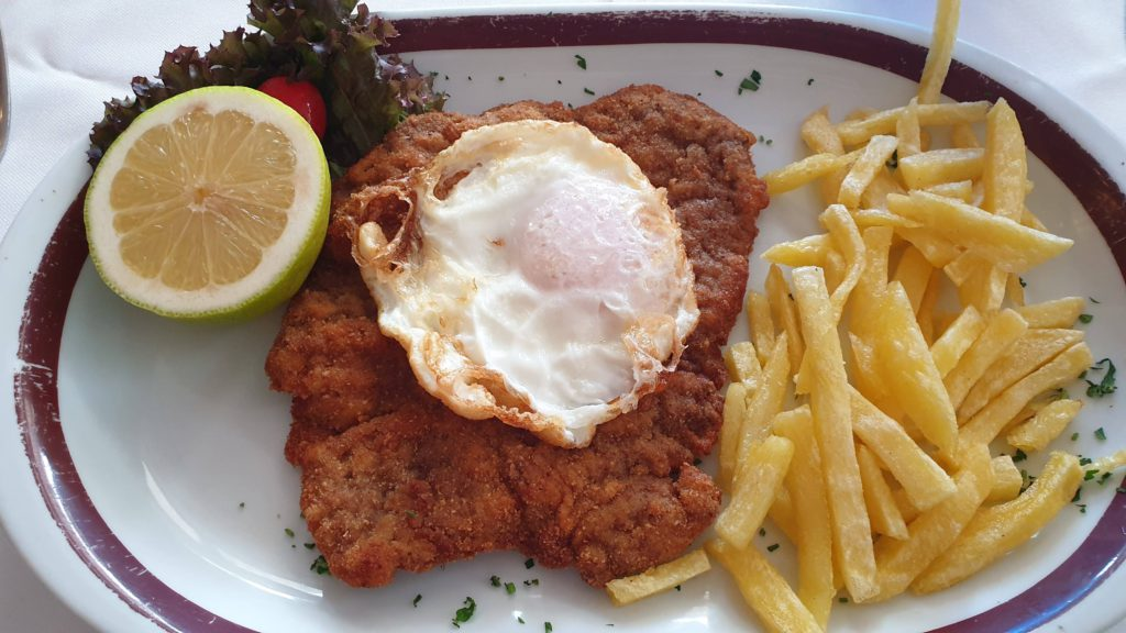 Escalope with natural french fries and egg