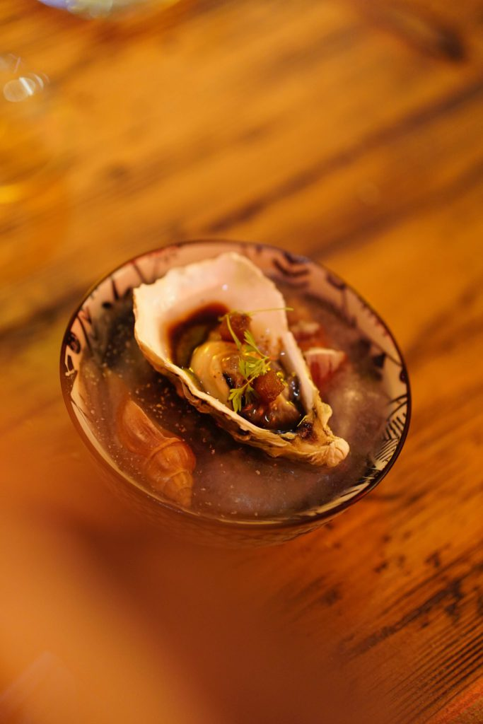 Pickled oyster with tsensuyu sauce and salicornia juice
