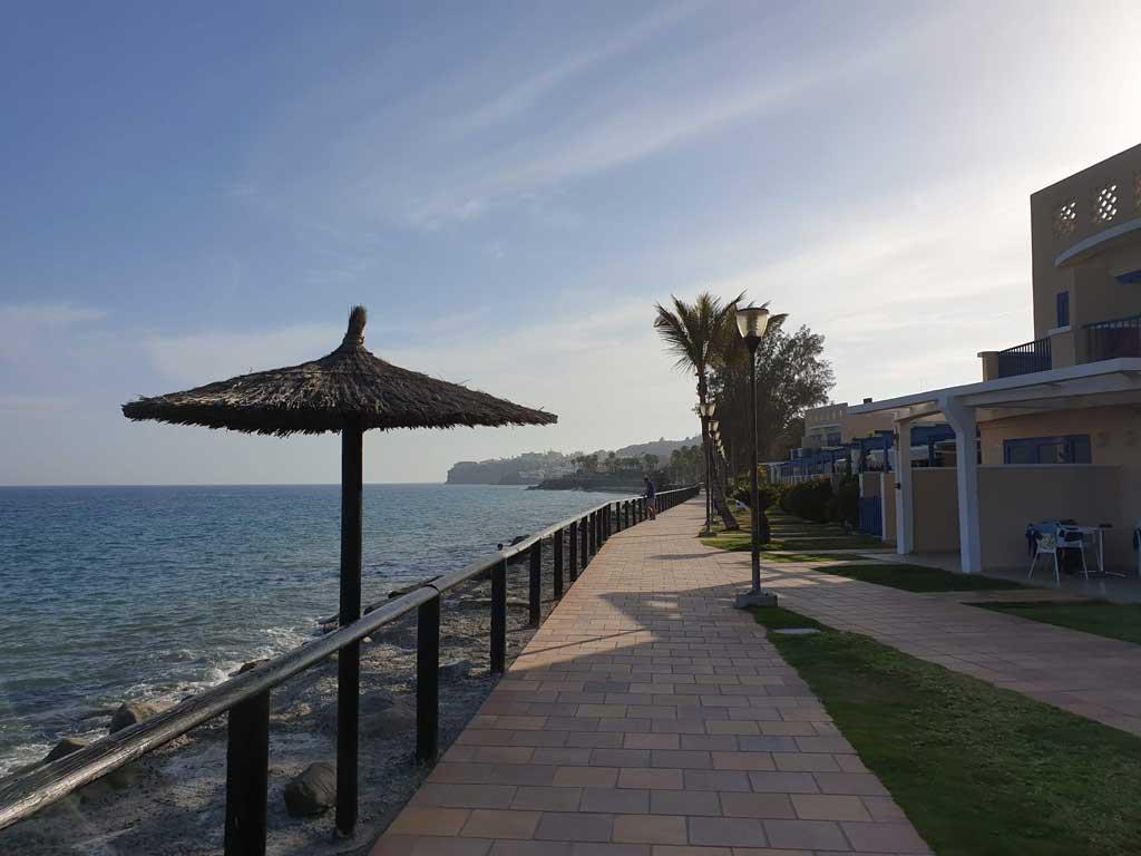 Promenade and apartments in Bahia Feliz beach