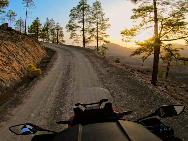 Gran Canaria by trail motorcycle. Sunset in Chira dam